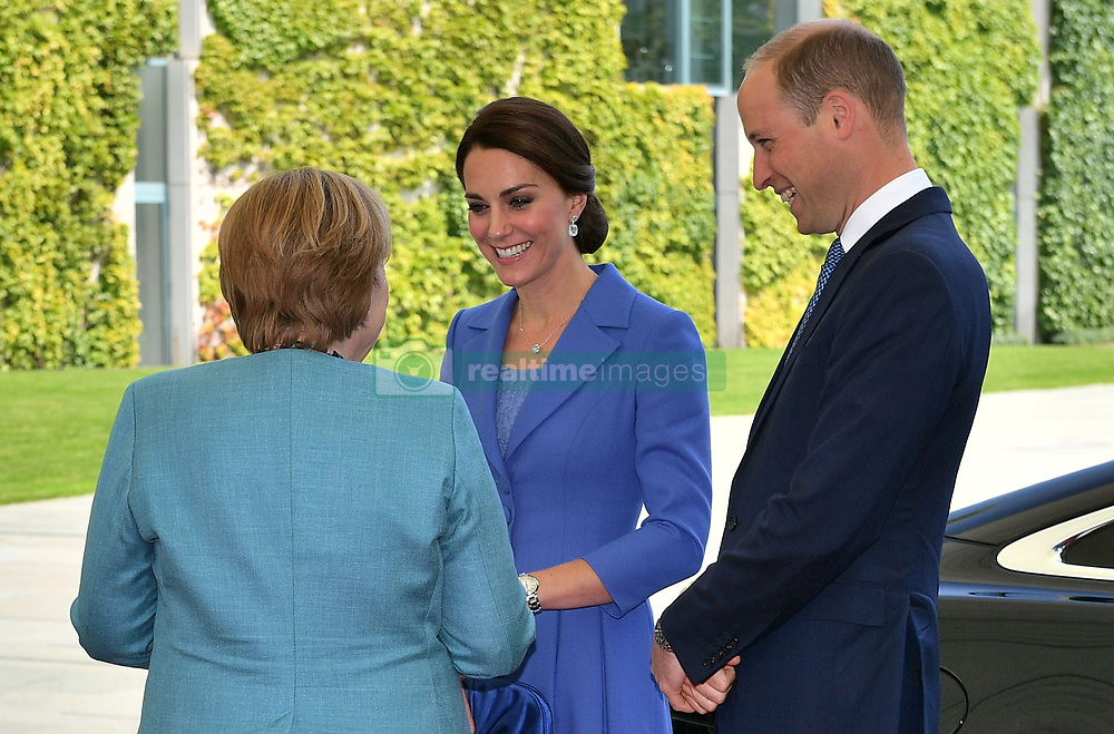 The Duke and Duchess of Cambridge is greeted by German Chancellor Angela Merkel as they arrive at the at the German Chancellory in Berlin.