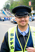 Happy Latino police crossing guard age 25. Cinco de Mayo Fiesta St Paul Minnesota USA