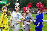 Repro Free: 16/08/2012 Maeve Byrne from Dundalk who won 'Most Colourful Outfit' pictured with Lucy Gilmore-Murphy from Enniskerry Co Wicklow who was crowned Blossom Hill 'Best Dressed Lady' and runner up Elaine Bury from Dunboyne and Joanne Murphy from Kilgarvan Co Kerry winner of 'Most Creative Hat'. Blossom Hill Ladies' Day took place at the Dublin Horse Show at the RDS. A fashion filled day, hundreds of ladies turned out for their chance to be crowned this year's Blossom Hill 'Best Dressed Lady'. Fashion expert Brendan Courtney from RTE's 'Off the Rails' was MC at the event and alongside rising Irish Designer (of Lady GaGa fame) Sorcha O'Raghallaigh and TV presenter Lucy Kennedy chose this year's winning look in the Blossom Hill 'Best Dressed Lady' category. The Blossom Hill 'Best Dressed Lady' won an incredible shopping trip to New York worth ?8,000! Other category winners included 'Most Colourful Outfit', 'Best Dressed Male' and 'Most Creative Hat'. Pic Andres Poveda ..For Further info contact:.Breda Brown / Frankie Bannon.Unique Media.Tel: (01) 522 5200 or (087) 7725661 (FB)