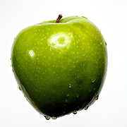 Granny Smith apple in studio.
