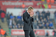 Swansea City Manager Garry Monk covers his face in frustration in the second half.<br /> Barclays Premier league match, Swansea city v Crystal Palace at the Liberty stadium in Swansea, South Wales on Saturday 29th November 2014<br /> pic by Phil Rees, Andrew Orchard sports photography.