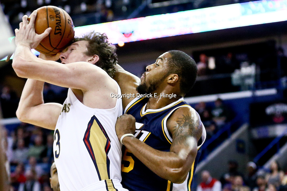 Feb 10, 2016; New Orleans, LA, USA; New Orleans Pelicans center Omer Asik (3) rebounds over Utah Jazz forward Derrick Favors (15) during the first quarter of a game at the Smoothie King Center. Mandatory Credit: Derick E. Hingle-USA TODAY Sports