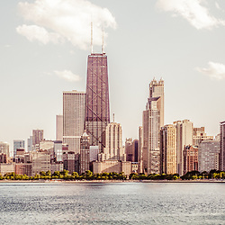 Chicago panorama retro photo of Chicago skyline with John Hancock Building and city skyscrapers. The John Hancock Center is one of the world's tallest skyscrapers and is a famous fixture in the Chicago skyline. Photo has a nostalgic vintage tone with a panoramic ratio of 1:3.