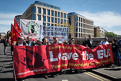 © Licensed to London News Pictures. 01/05/2016. London, UK. Protesters carry a Communist Party 'Leave the EU' banner at a May Day protest in central London. Jeremy Corbyn, Leader of the Labour Party, spoke at the opening rally. Photo credit : Rob Pinney/LNP