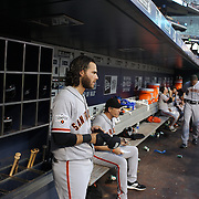 Brandon Crawford, (left), San Francisco Giants, in the dugout preparing to bat during the New York Mets Vs San Francisco Giants MLB regular season baseball game at Citi Field, Queens, New York. USA. 11th June 2015. Photo Tim Clayton