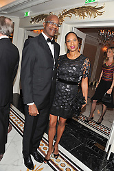 EDWIN MOSES and his wife MICHELLE at the 22nd Cartier Racing Awards held at The Dorchester, Park Lane, London on 13th November 2012.