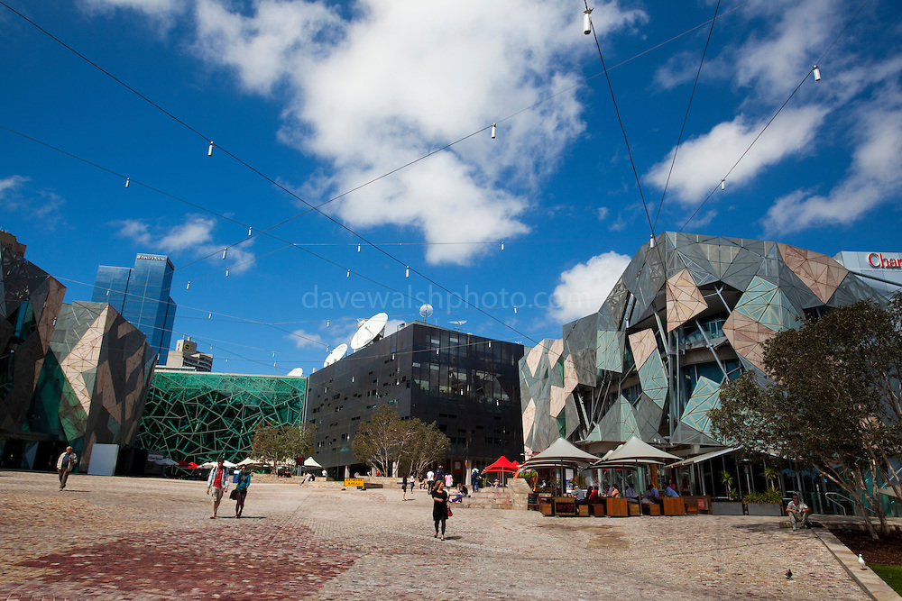 Federation Square, Melbourne. On the left is the Arthur Deaking Building. The green building centre is The Atrium.