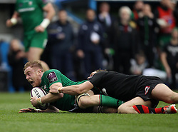 London Irish's Eoin Griffin is tackled - Photo mandatory by-line: Robbie Stephenson/JMP - Mobile: 07966 386802 - 05/04/2015 - SPORT - Rugby - Reading - Madejski Stadium - London Irish v Edinburgh Rugby - European Rugby Challenge Cup