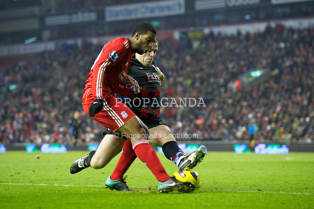 LIVERPOOL, ENGLAND - Monday, December 6, 2010: Liverpool's Ryan Babel and Aston Villa's Richard Dunne during the Premiership match at Anfield. (Photo by: David Rawcliffe/Propaganda)