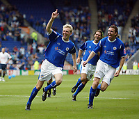 Photo: Chris Ratcliffe.<br />Leicester City v Ipswich Town. Coca Cola Championship. 12/08/2006.<br />Stephen Hughes (L) celebrates putting Leicester into a 2-0 lead as Eric Nils-Johansson chases him (R).