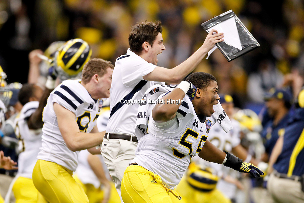 January 3, 2012; New Orleans, LA, USA; Michigan Wolverines defensive end Jibreel Black (55) reacts to the game winning field goal in overtime against the Virginia Tech Hokies in the Sugar Bowl at the Mercedes-Benz Superdome. Michigan defeated Virginia 23-20 in overtime. Mandatory Credit: Derick E. Hingle-US PRESSWIRE