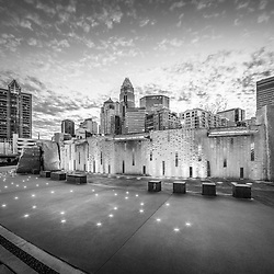 Charlotte NC skyline black and white photo with Romare Bearden Park at dusk. Charlotte, North Carolina is a major city in the Eastern United States of America.