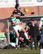 26th December 2017, Dens Park, Dundee, Scotland; Scottish Premier League football, Dundee versus Celtic; Dundee's Sofien Moussa out jumps Celtic's Kieran Tierney