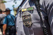 Jul 20, 2016; Cleveland, OH, USA; An officer wears a badge with a black bar in downtown Cleveland at the site of the Republican National Convention.