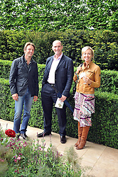 Left to right, garden designer LUCIANO GIUBBILEI, LAWRENCE DALLAGLIO and his wife ALICE at the RHS Chelsea Flower Show 2009 held inthe gardens of the Royal Hospital Chelsea on 18th May 2009.