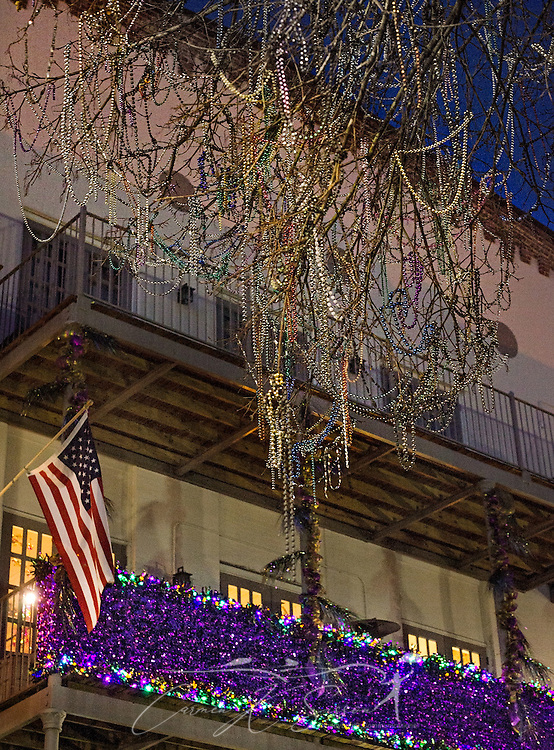 A balcony is decorated for Mardi Gras and beads hang from an oak tree, January 14, 2017, on Dauphin Street in downtown Mobile, Alabama. Mobile considers itself the home of the nation's first Mardi Gras, dating back to 1703. The official colors of Mardi Gras are green, purple, and gold, representing faith, justice, and power. (Photo by Carmen K. Sisson/Cloudybright)