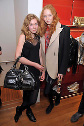 Left to right, IMOGEN POOTS and LILY COLE at a party in aid of the charity Best Buddies held at the Hogan store, 10 Sloane Street, London SW10 on 13th May 2009.