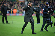 Norwich City manager Daniel Farke celebrates in front of the fans after the EFL Sky Bet Championship match between Norwich City and Queens Park Rangers at Carrow Road, Norwich, England on 6 April 2019.