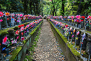 At Zojo-ji Temple, in the heart of Tokyo, several hundred Jizo statues have been decorated with colorful caps and bibs, and feature small windmills that turn when there is a breeze.