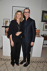 ARABELLA POLLEN and BRUNO FRISONI at a lunch hosted by Roger Vivier held at Bella Pollen's home, 5 Stanley Crescent , London on 29th January 2013.