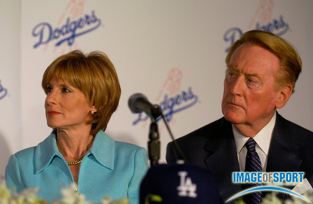 Jan 29, 2004; Los Angeles, CA, USA; Jamie McCourt and Vin Scully during press conference announcing Frank McCourt's purchase of Los Angeles Dodgers at Dodger Stadium.