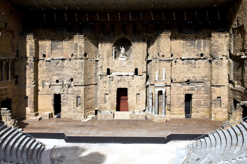 The stage and famed acoustic wall of the Theatre Antique in Orange. Dating from the 1st century AD and protected as an UNESCO World Heritage site, the Roman theatre in Orange is well preserved and unique in Europe because of its original acoustic wall.  The theatre remains in use today.