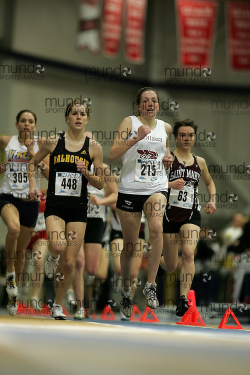 (Windsor, Ontario---13 March 2010) Julia Malleck of University of Ottawa Gee-Gees   competes in the 1500m final at the 2010 Canadian Interuniversity Sport Track and Field Championships at the St. Denis Center. Photograph copyright Sean Burges/Mundo Sport Images. www.mundosportimages.com