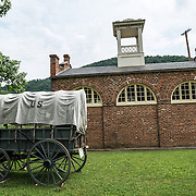A wagon in front of John Brown's Fort at Harpers Ferry in West Virginia. On October 17, 1859, Brown led an attack on Harpers Ferry to launch a war against slavery. This is not the original site of the fort. It was originally located a few hundred feet away but was moved to accommodate the construction of a railway line.