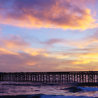 Balboa Pier sunset panoramic photo in Newport Beach California. Newport Beach is an afflient coastal beach city along the Pacific Ocean in Orange County Southern California. Panoramic photo ratio is 1:3. Copyright ⓒ 2017 Paul Velgos with All Rights Reserved.
