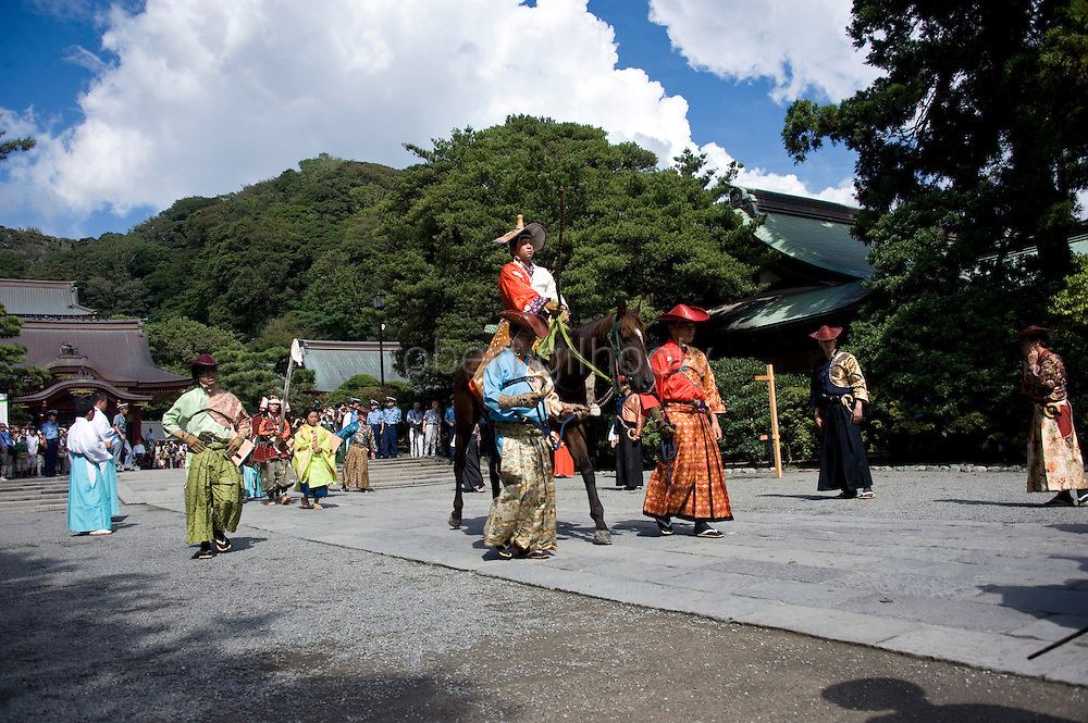 A horseback archer dressed in samurai garb prepares to take part in the yabusame ritual at the annual Reitaisai Grand Festival at Tsurugaoka Hachimangu Shrine in Kamakura, Japan on  14 Sept. 2012.  Sept 14 marks the first day of the 3-day Reitaisai festival, which starts early in the morning when shrine priests and officials perform a purification ritual in the ocean during a rite known as hamaorisai and limaxes with a display of yabusame horseback archery. Photographer: Robert Gilhooly