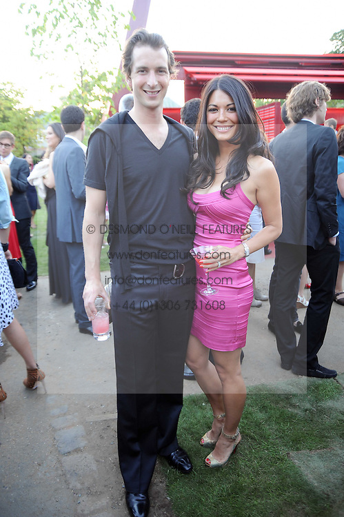The HON.WILL ASTOR and his wife LOHRALEE at the annual Serpentine Gallery Summer party this year sponsored by Jaguar held at the Serpentine Gallery, Kensington Gardens, London on 8th July 2010.  2010 marks the 40th anniversary of the Serpentine Gallery and the 10th Pavilion.