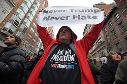 January 20, 2017 - Washington, District of Columbia, U.S. - JEFF BRUCE of Boston wears a 'Not My President, Love Trumps Hate' tshirt as he holds a sign that reads 'Never Trump, Never Hate'  waiting in security line before entering inauguration event. (Credit Image: © Lloyd Fox/TNS via ZUMA Wire)