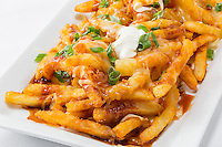 French fries,gravy,green onions,cheese,sour cream