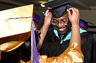 Principal David E. Lawrence gets a last minute cap adjustment before the Thurgood Marshall High School commencement at the Dayton Masonic Center, Tuesday, May 24, 2011.