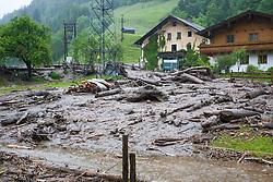 02.06.2013, B311, Hoegmoos, AUT, Pinzgau starke Regenfaelle, im Bild Wohnhaeuser beim Murenabgang an der B311 bei Hoegmoos. Die Strasse wurde fuer den Verkehr gesperrt. Starkregen sorgt derzeit vor allem in Tirol, Oberoesterreich und Salzburg für massive Überflutungen, Vermurungen und Hangrutsche // Parts of Pinzgau were declared a disaster area. Heavy rain is currently making, especially in Tyrol, Upper Austria and Salzburg for massive flooding, mudslides and landslides, Hoegmoos, Austria on 2013/06/02. EXPA Pictures © 2012, PhotoCredit: EXPA/ Juergen Feichter