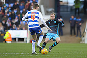George Evans battling with Sheffield Wednesday Midfielder Barry Bannan during the Sky Bet Championship match between Reading and Sheffield Wednesday at the Madejski Stadium, Reading, England on 23 January 2016. Photo by Phil Duncan.