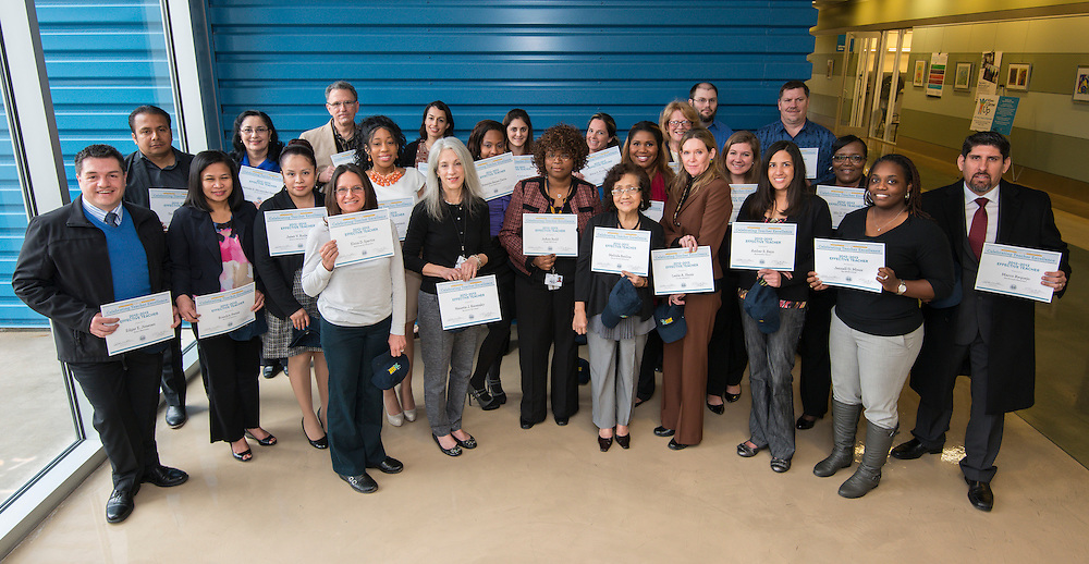 Houston ISD highly effectve teachers pose for a photograph after being recognized during a breakfast and principal meeting, March 5, 2014.