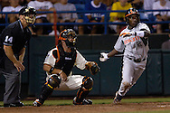 Miami's Jemile Weeks drives the ball to right field against Oregon State, during the College World Series at Rosenblatt Stadium in Omaha, Nebraska, June 17, 2006.