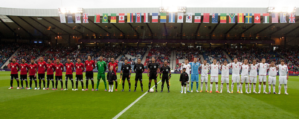 Egypt and Belarus line for the national anthems. Egypt v Belarus. Men's Olympic football, Preliminaries Round Group C. Hampden Park 1.8.2012. (c) Stephen Smyth | StockPix.eu