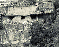 A distant view of the remnant of an ancient cliff dwelling in Walnut Canyon