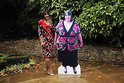 Kim Freshwater, 45, who lost 17st 5llb/110 kg and the slimming world woman of the year, with a cutout of herself, 2 and a half years ago, in London, United Kingdom. Tuesday, 12th November 2013. Picture by Max Nash / i-Images