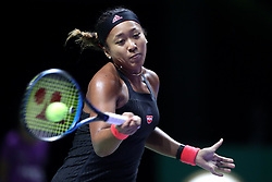 October 24, 2018 - Singapore - Naomi Osaka of Japan returns a shot during the match between Angelique Kerber and Naomi Osaka on day 4 of the WTA Finals at the Singapore Indoor Stadium. (Credit Image: © Paul Miller/ZUMA Wire)