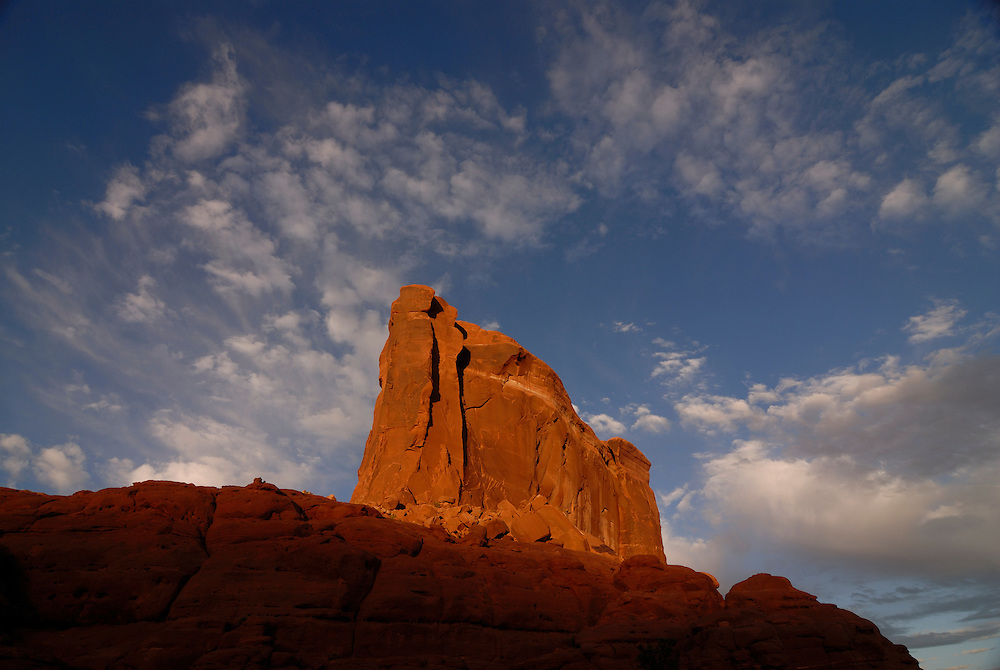 Giant rock in the late afternoon light on top of a plateau near Moab, Utah, USA