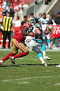 Carolina Panthers rookie running back Christian McCaffrey (22) gets stripped of the ball by San Francisco 49ers cornerback Rashard Robinson (33) as he is tackled by San Francisco 49ers outside linebacker Ray-Ray Armstrong (54) during the 2017 NFL week 1 regular season football game against the against the San Francisco 49ers, Sunday, Sept. 10, 2017 in Santa Clara, Calif. The Panthers won the game 23-3. (©Paul Anthony Spinelli)