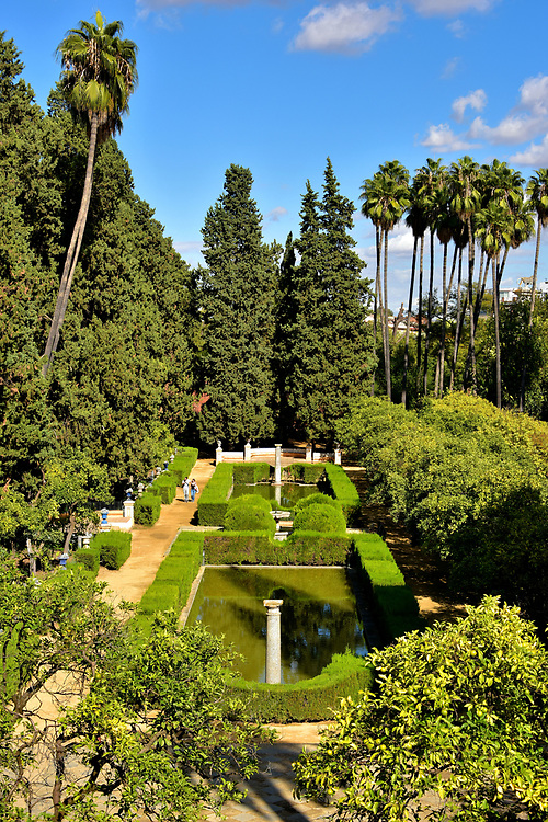 Gardens at Real Alc&aacute;zar in Seville, Spain<br /> All of the Al-Andalus palaces preserved in Spain are surrounded by elaborate gardens. Real Alc&aacute;zar is a beautiful example. Imagine strolling along a labyrinth of paths through 17 acres of sculpted bushes, fruit orchards, flower beds, Mediterranean trees and palms accented by reflection ponds, fountains and columns. Much of the garden&rsquo;s appearance you will enjoy today was created by Vermondo Resta during the 16th century.
