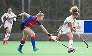 BILTHOVEN - hoofdklasse competitie dames, SCHC-Amsterdam. Caia van Maasaker (SCHC) met rechts Maria Verschoor (A'dam)   COPYRIGHT KOEN SUYK