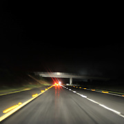 The night view of a motorway as seen from inside a car.