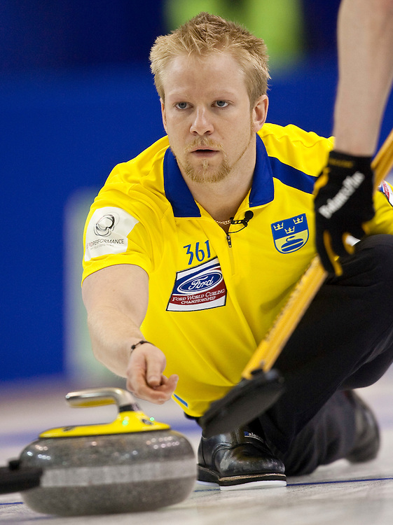 Swedish skip Niklas Edin releases a shot during the bronze medal match against Norway at the Ford World Men's Curling Championships in Regina, Saskatchewan, April 10, 2011.<br /> AFP PHOTO/Geoff Robins