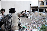 "Heroin addicts consume their daily doses, probably the last before leave Morgh Mandi, one of the most crowded place by the druggies in Rawalpindi. Pakistan, on thursday, August 14 2008.....""Pakistan is one of the countries hardest hits by the narcotics abuse into the world, during the last years it is facing a dramatic crisis as it regards the heroin consumption. The Unodc (United Nations Office on Drugs and Crime) has reported a conspicuous decline in heroin production in Southeast Asia, while damage to a big expansion in Southwest Asia. Pakistan falls under the Golden Crescent, which is one of the two major illicit opium producing centres in Asia, situated in the mountain area at the borderline between Iran, Afghanistan and Pakistan itself. .During the last 20 years drug trafficking is flourishing in the Country. It is the key transit point for Afghan drugs, including heroin, opium, morphine, and hashish, bound for Western countries, the Arab states of the Persian Gulf and Africa..Hashish and heroin seem to be the preferred drugs prevalence among males in the age bracket of 15-45 years, women comprise only 3%. More then 5% of whole country's population (constituted by around 170 milion individuals),  are regular heroin users, this abuse is conspicuous as more of an urban phenomenon. The substance is usually smoked or the smoke is inhaled, while small number of injection cases have begun to emerge in some few areas..Statistics say, drug addicts have six years of education. Heroin has been identified as the drug predominantly responsible for creating unrest in the society."""