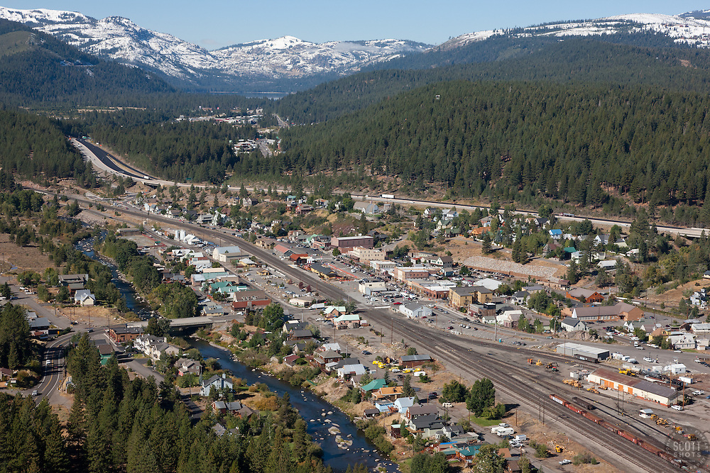 """Downtown Truckee Aerial 1"" - Downtown Truckee photographed from a small amphibious seaplane with the door removed. Donner Lake can be seen in the distance."